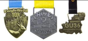 Europa Medals Lined up 7 - Englefield 10K, Hive Running Club, GU36 Ultramarathon